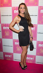 Michelle Heaton wore a pair of leather peep-toe pumps with her color-block dress at the New Magazine birthday bash.