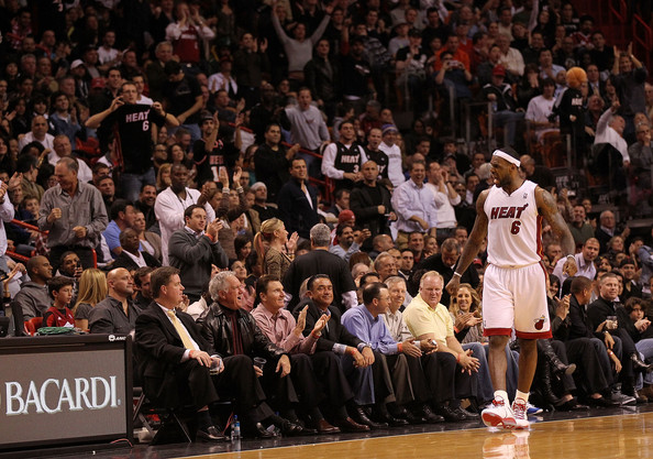 More Pics of LeBron James Track Jacket (1 of 14) - LeBron James Lookbook - StyleBistro [photograph,audience,crowd,product,fan,basketball player,basketball moves,basketball,player,team sport,sport venue,lebron james 6,user,crowd,user,note,miami,miami heat,new orleans hornets,game]