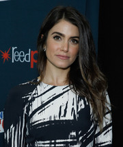 Nikki Reed attended New York Comic-Con 2015 wearing edgy-glam tresses.