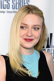 Dakota Fanning attended the premiere of 'Every Secret Thing' wearing her blonde locks in a half-pinned layered style.