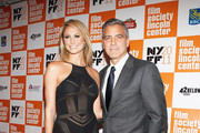 Stacy Keibler and Actor George Clooney attend New York Film Festival 2011 on October 16, 2011 in New York City.