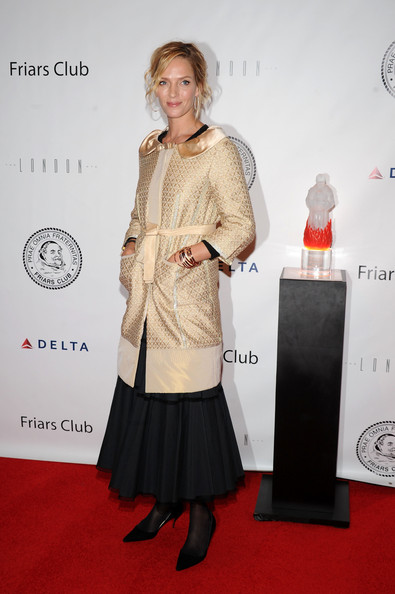 Actress Uma Thurman attended the Friars Club roast of Quentin Tarantino wearing a variety of rose gold bangles.