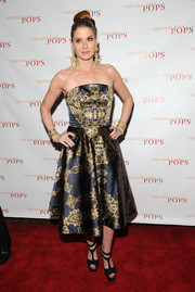 Debra Messing chose a black and gold rococo-print strapless dress by Christian Siriano for the New York Pops 31st birthday gala.