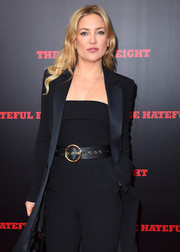 Kate Hudson teamed a broad black belt with a matching jumpsuit and coat for the New York premiere of 'The Hateful Eight.'