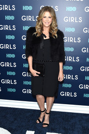 Rita Wilson layered a black fur jacket over her dress for an even chicer look.