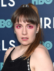 For her beauty look, Lena Dunham kept it fun and playful with heavy hot-pink eyeshadow.