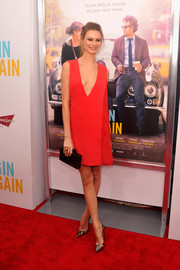 Behati Prinsloo looked daring yet chic in a red mini dress with a deep-V neckline during the premiere of 'Begin Again.'