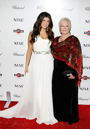 A printed red silk scarf is Judi Dench's accessory of choice during the New York screening of Nine.