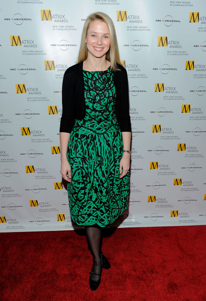 Marissa Mayer paired a green and black print dress with a black cardigan for her Matrix Awards red carpet look.