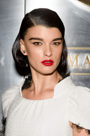 Crystal Renn accessorized with simple silver studs.