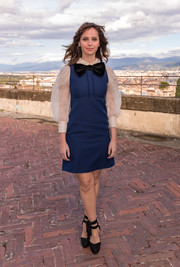 Felicity Jones styled her look with a pair of black ankle-tie platform pumps.