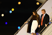 Melania Trump touched down in Buenos Aires wearing a brown leather coat by Ralph Lauren.