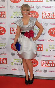 Katie Piper modernized her architectural cocktail dress with black booties.