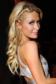 Paris Hilton added a pretty French braid to her signature hair look featuring long soft waves.