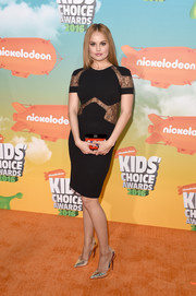 Debby Ryan chose a pair of silver cutout pumps to team with her dress.