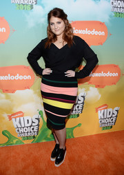 Meghan Trainor spiced up her plain blouse with a multicolored striped pencil skirt.