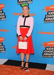 Kristen Bell paired her blouse with a flared red skirt, also by Emilia Wickstead.