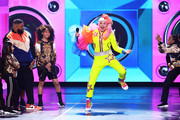 JoJo Siwa danced onstage at the 2019 Kids' Choice Awards wearing a bright yellow jumpsuit with a mega-ruffled sleeve.