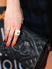 Pixie wore a gold cocktail ring with her first name initial engraved in it.