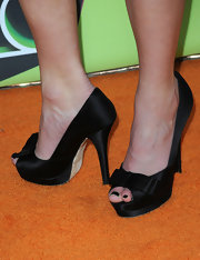 Pixie Lott showed off her peep toe satin pumps while walking the carpet. The bow embellishment gave them a fun and flirty touch.