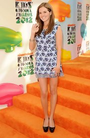 Zoey Deutch arrived at the 2012 Kids' Choice Awards wearing pave diamond bangle bracelets along with a matching pave diamond band rings.