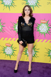 Liz Gillies opted for a pair of simple short shorts to go with her attention-grabbing top at the KCA.