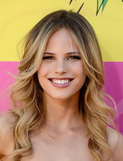Halston Sage showed off her dirty blonde locks with this wavy 'do with a stylish center part.