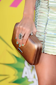Ashley Tisdale sported this chic, white gold ring with falcon eye center stone surrounded by diamonds.
