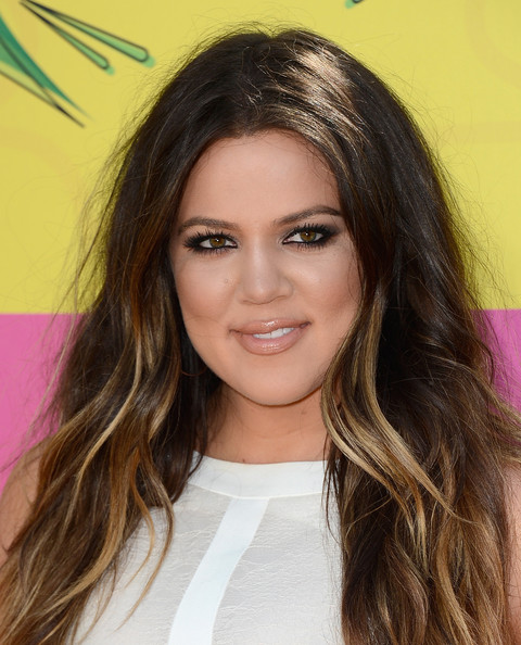Khloe Kardashian proved you don't always need a bold lip for a sexy red carpet look when she stepped out sporting this glossy nude lip.