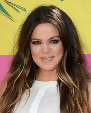 Khloe Kardashian showed off her sun-kissed highlights with this beachy, wavy 'do.