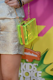 Bella Thorne added some youthful flare to her classy red carpet look with this neon hard case clutch.