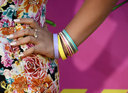 Rachel Crow added even more color to her look with these pastel bangles.
