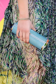 Miranda Cosgrove carried this cool cylindrical clutch to top off her funky red carpet look at the Kids' Choice Awards.