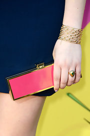 Jennette McCurdy chose this slender, pink clutch to add just a dash of color to her navy dress at the KCAs.