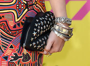 Olivia Holt added some rocker-edge to her red carpet look with this lip-shaped, studded clutch.