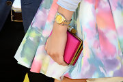 Zendaya Coleman chose a hot pink, satin, hard case clutch for her look on the purple carpet at the KCAs.