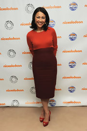 Ann Curry paired a high-waist maroon pencil skirt with an orange knit top for a trendy color-blocked finish during the anniversary celebration of 'Nick News.'