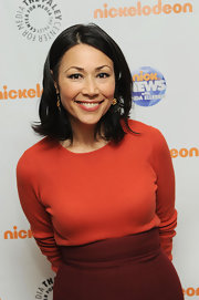 Ann Curry tried a bit of color blocking with an orange knit top and a high-waist maroon skirt during the 20th anniversary celebration of 'Nick News.'