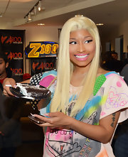 Nicki Minaj swept on bubblegum pink lipstick for a visit to a radio show in NYC.