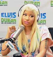 Nicki Minaj showed off her brightly painted nails featuring brush strokes in shades of pink, yellow and blue.