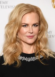 Nicole Kidman looked picture-perfect with her high-volume waves at the photocall for her 'A Life in Pictures' retrospective.