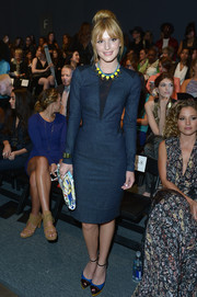Bella Thorne cut a slim silhouette in a long-sleeve blue sheath with black accents at the Nicole Miller fashion show.