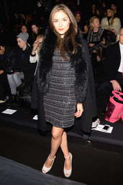 Olivia Culpo cut a regal figure in a black fur-trimmed coat during the Nicole Miller fashion show.