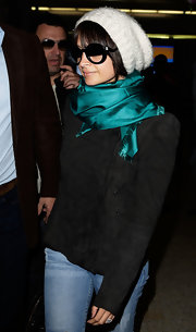 Nicole arrived in Sydney all bundled up in a silk scarf and a soft knitted beanie.