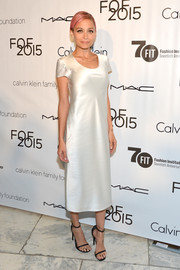 Nicole Richie was all about simple elegance in a white silk T-shirt dress during the Future of Fashion Runway Show.