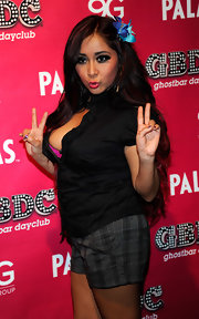 Snooki rang in the new year in a pair of plaid trouser shorts that showed off her newly slimmed down frame.