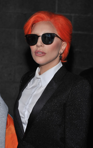Lady Gaga topped off her head-turning look with a pair of Le Specs shades.