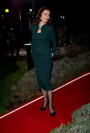 Amanda Donohoe paired a regal emerald green dress with sophisticated leather platforms.