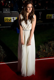 Stacey wears a floor length white chiffon evening gown. A super sweet look!