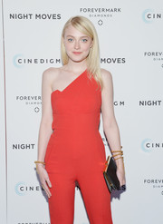 Dakota Fanning styled her red jumpsuit with beaded gold bracelets by Paula Mendoza when she attended the 'Night Moves' premiere.